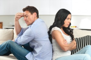 Young couple fighting sitting back to back. Relationship counselling helps restore communication.